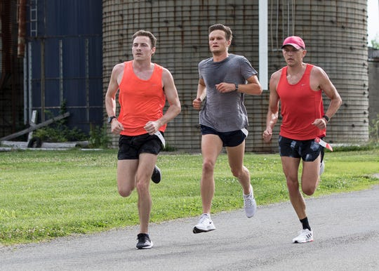 Seth Farmer from Waverly, left, pulls away from Corey Culbertson and Thryceton Deckard to take first place with a time of 16:52.20 at the first Zach Farmer 5K race on June 27, 2020. The event was organized to help the Zach Farmer Cancer Foundation help provide money for gas, hotel stays, food, and other related expenses for those dealing with cancer.