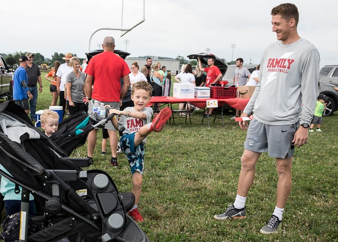 Kobe Miller shows his dad Kyle Miller that he can stretch for races too before the beginning of the first Zach Farmer 5K race on June 27, 2020. The event was organized to help the Zach Farmer Cancer Foundation help provide money for gas, hotel stays, food, and other related expenses for those dealing with cancer.
