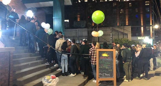 More than 50 people stood in line waiting to get into Harper's in East Lansing in late March, despite officials' warnings. Fourteen men and women who visited the brewpub in June have been confirmed to have the coronavirus.