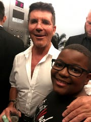 """Kodie Chandler bumped into """"America's Got Talent"""" producer and judge Simon Cowell in an elevator when he was in California competing on the show with the Detroit Youth Choir in 2019. His parents, Denise and Richard Chandler, snapped a photo."""