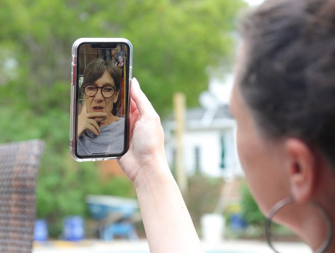 Emily Summerfield does a video chat with her mother Sally Blyth who lives in Canada on June 26, 2020.  The two often talk about the day's events over a glass of wine. Her mom and stepdad Alan Bull are in Canada and due to the border being closed she is unable to visit and help her mom deal with her stepdads medical conditions.