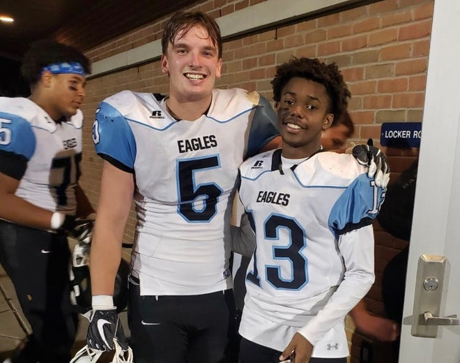 Grand Rapids Christian football players John Holmes, left, and Brian Hunter after a game in the 2019 season.