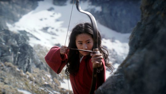 """This image released by Disney shows Yifei Liu in the title role of """"Mulan."""" Disney said Friday, June 26, 2020 that it would delay the release of the live-action adaptation until Aug, 21, 2020, after having already delayed its release from March until July because of the coronavirus pandemic."""