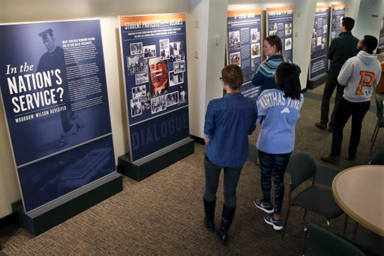 "Princeton University students walk through an exhibit titled, ""In the Nation's Service? Woodrow Wilson Revisited"" April 3, 2016, at the Woodrow Wilson School of Public and International Affairs in Princeton, N.J."
