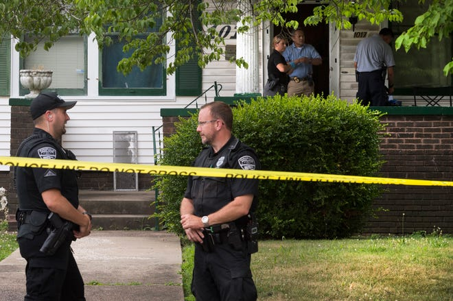 The Evansville Police Department investigate a shooting that killed two people at 1017 Chandler Avenue in Evansville, Ind., Saturday, June 27, 2020. The two people killed and the suspected shooter appears to be family members according to the EPD.