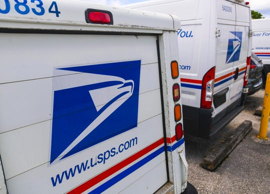 Postal delivery vehicles are seen parked within the Guam Main Facility compound in Barrigada on Saturday, June 27, 2020. Authorities continue to intercept drugs in the mail on Guam even during the pandemic, according to data from U.S. Postal Inspection Service.