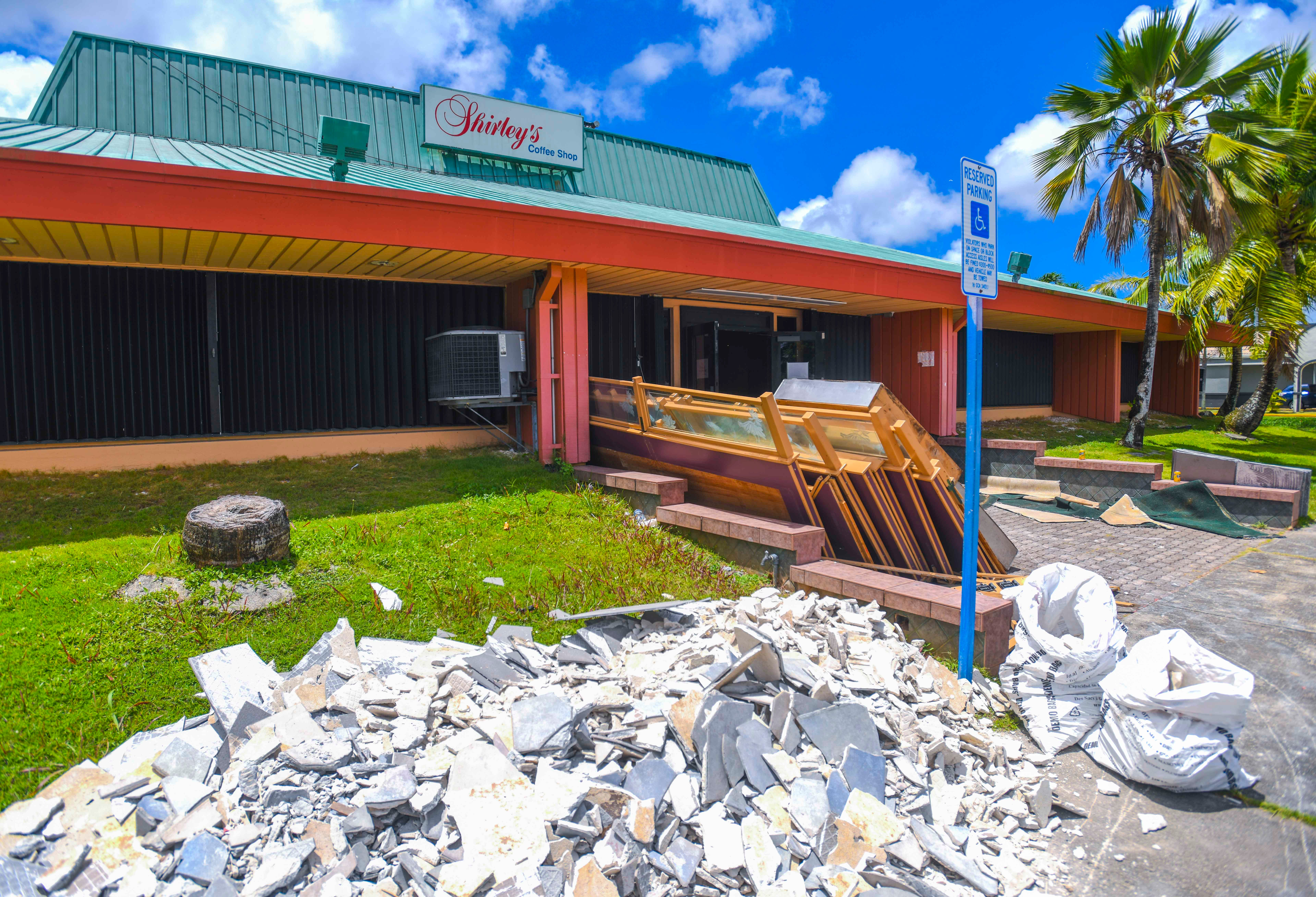 Construction debris can be found outside the former Shirley's Coffee Shop as demolition work is performed within the building, near the Agana Shopping Center, on Saturday, June 27, 2020.