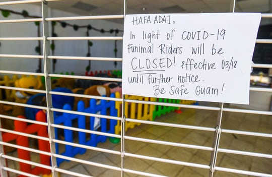 A sign posted on a security gate of the Funimal Riders store in the Agana Shopping Center, seen here on June 27, 2020, informs shoppers of the company's decision to temporarily close the business due to the coronavirus pandemic.