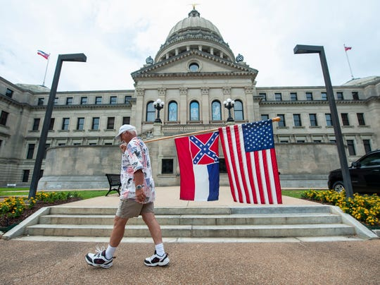 Don Hartness, of Ellisville, continues his vigil of circling the Mississippi State Capitol outside, as legislators continue the debate over the state flag inside Saturday, June 27, 2020. Hartness arrived at about 6 a.m. and began walking at 7. By about 10 a.m. he'd made a dozen loops.