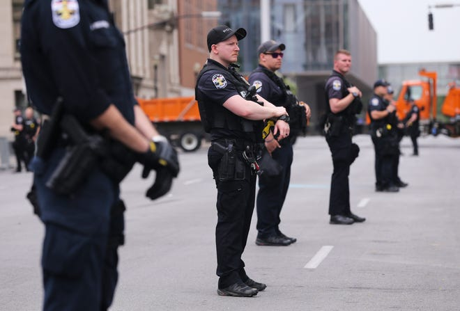 Louisville Metro Police officers stationed outside Jefferson Square Park on June 27, 2020.