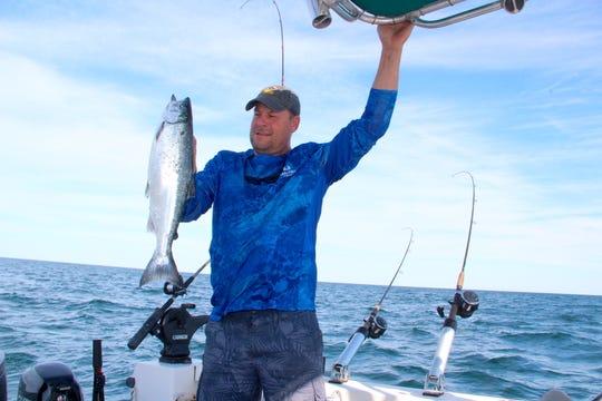 Brian Settele of Menomonee Falls holds a 5-pound coho salmon caught fishing in Lake Michigan off Oak Creek.
