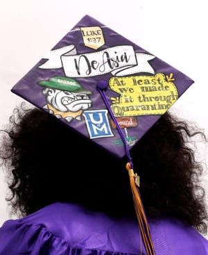 Smyrna High School graduate DeAsia Mallory showed off her decorated cap while waiting for the drive-thru graduation ceremony at the school to begin on Saturday, June 27, 2020.