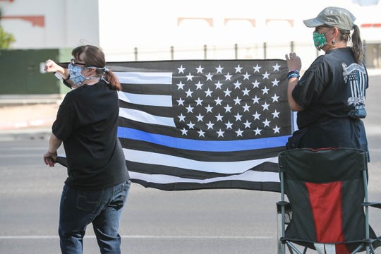 """Demonstrators gather at Picacho Avenue and Main Street in support of law enforcement in a """"Back The Blue"""" event in Las Cruces on Saturday, June 27, 2020."""