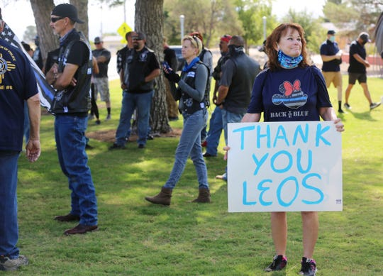 Laura Valdez holds a sign at Albert Johnson Park thanking law enforcement officers Saturday, June 27, 2020. Valdez's husband, who served as a police officer in Las Cruces for 20 years, died Aug. 22, 2019, of metastasized kidney cancer.