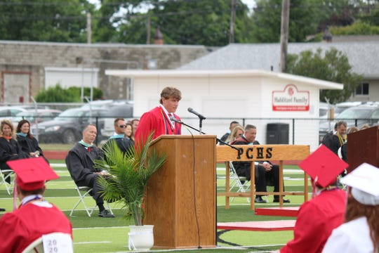 Cooper Stine, of Port Clinton High School's Class of 2020, addresses his fellow classmates during the 136th annual commencement ceremony at True Lay Stadium on Saturday.