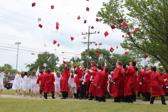 Port Clinton High School's Class of 2020 toss their caps in the are after the 136th annual commencement ceremony at True Lay Stadium on Saturday.