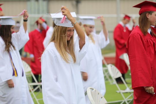 Port Clinton High School's Class of 2020 turn their tassels as part of the 136th annual commencement ceremony at True Lay Stadium on Saturday.