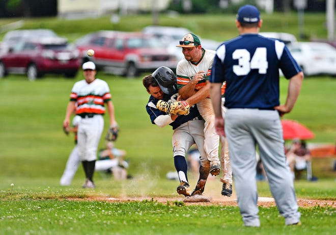 Glen Rock's Scott Merkel, center left, and Jefferson's Tyler Troxel center right, collide at first during Central League baseball action in Jefferson, Saturday, June 27, 2020. Jefferson would win the game 3-2 in an eighth inning. Dawn J. Sagert photo