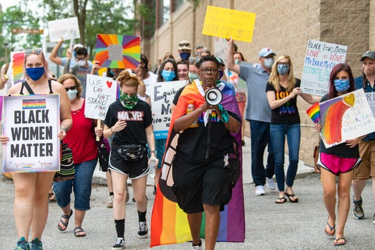 Rainbow Rose Center Vice President Maria McCargo Gable leads a march in support of the Black Lives Matter movement and the LGBTQ community, Saturday, June 27, 2020, in York. The rally, hosted by the Rainbow Rose Center, started at Penn Park and continued to Cherry Lane.