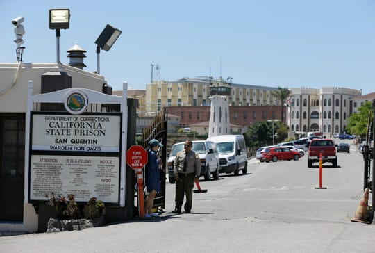 FILE - In this July 24, 2019, file photo, is the main entryway leading into San Quentin State Prison in San Quentin, Calif. Gov. Gavin Newsom is proposing to significantly shrink the footprint of California's juvenile and adult prison system, partly because of massive budget cuts prompted by the pandemic but also as a philosophy. (AP Photo/Eric Risberg, File)