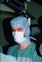 Dr. John Harch is seen in the 1980s during his surgical residency at a trauma hospital in the Los Angeles area.