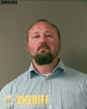Rian Alden booking photo released by the Washington County Sheriff's Office. Alden, a Washington County Sheriff's deputy, was arrested Friday, June 26, 2020, on assault and other charges after a man was slammed into a wall and thrown down in a jail booking area in 2018, fracturing his skull and causing what his lawyer calls a permanent brain injury. (Washington County Sheriff's Office via AP)