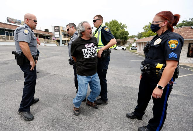 A protester is arrested Saturday, June 27, 2020, outside Dixie Outfitters in Branson.