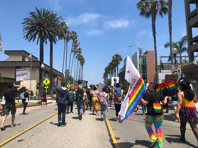 The crowd heads toward the Third Street bridge as part of the Black Lives Pride March in Oxnard on Friday, June 26, 2020.