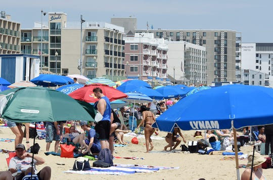 Hot weather and clear skies brought thousands of visitors to Rehoboth Beach on Saturday, June 27. Social distancing did not appear to be followed very strictly on either the beach or boardwalk, with mask usage also not universal.