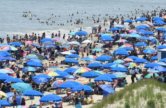 Hot weather and clear skies brought thousands of visitors to Rehoboth Beach on Saturday, June 27, 2020. Social distancing did not appear to be followed very strictly on either the beach or boardwalk, with mask usage also not ubiquitous.