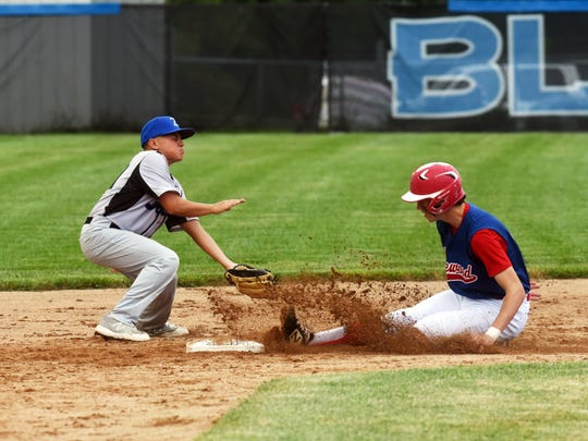 Zanesville's Cohen Bunting lays a tag on a running from Lakewood during the Blue Devils' game on Wednesday at Jay Payton Field. The summer team coached by David Balo consists of junior varsity and varsity players who didn't get to play when schools were shut down due to COVID-19.