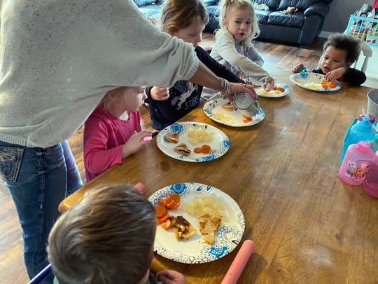 Wendy Tilma serves a lunch of hot chicken quesadillas and canned fruits and vegetables to the five kids she cares for in her Byron Center, Michigan, home during the school day.