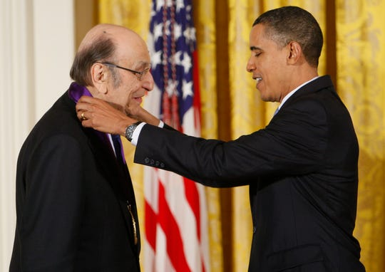 In this Thursday, Feb. 25, 2010, file photo, President Barack Obama presents a 2009 National Medal of Arts to Milton Glaser, in the East Room of the White House in Washington.