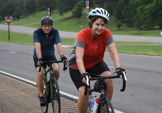 Steve Banick (back) and Helen Caletka both recently got into cycling with encouragement from Banick's wife Tami Banick.