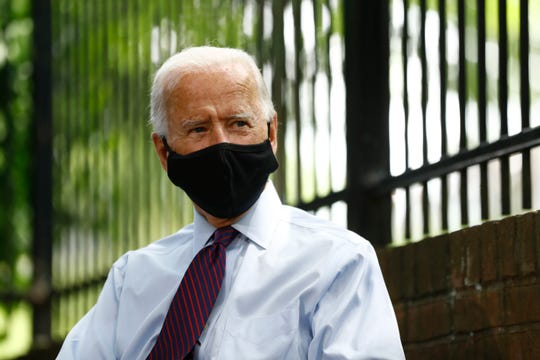 Democratic presidential candidate, former Vice President Joe Biden pales while speaking with families who have benefited from the Affordable Care Act, Thursday, June 25, 2020, in Lancaster, Pa.