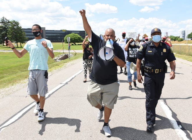 Eric Pate, center, of Southfield co-organized the Southfield march Sunday.