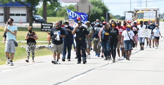 Protesters march on Civic Center Drive to the Southfield civic center.