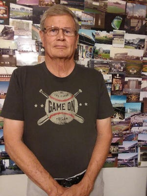 Jim Shaffer has visited every current MLB ballpark, and many more. Several are in photographs in a collage behind him.