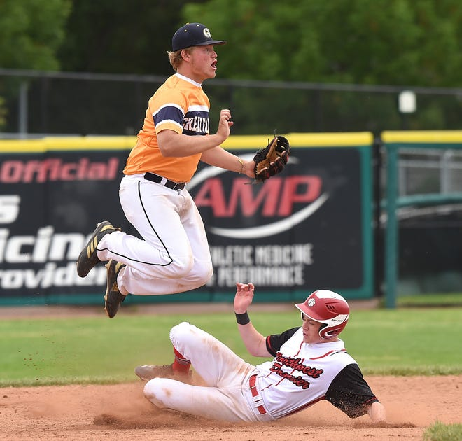 Great Falls Chargers' Kam Richards jumps over Northwest Premier Black's Cam Harris at second base during play in the championship game at the Goldsmith Gallery Jewelers American Legion baseball tournament at Dehler Park on Sunday.