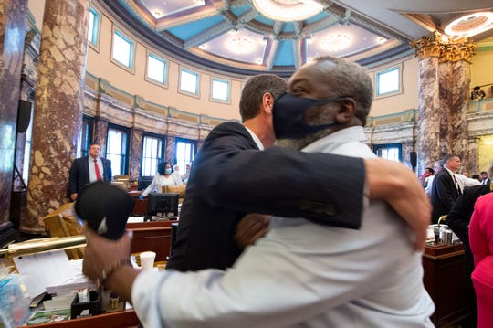 Rep. John Faulkner, D-Holly Springs, foreground, congratulates Sen. Briggs Hopson, R-Vicksburg, after House Bill 1796, the bill to change the state flag, passed 37-14 at the Mississippi State Capitol in Jackson, Miss., Sunday, June 28, 2020. Both chambers of the Mississippi Legislature passed the bill. Gov. Tate Reeves said he will sign it.