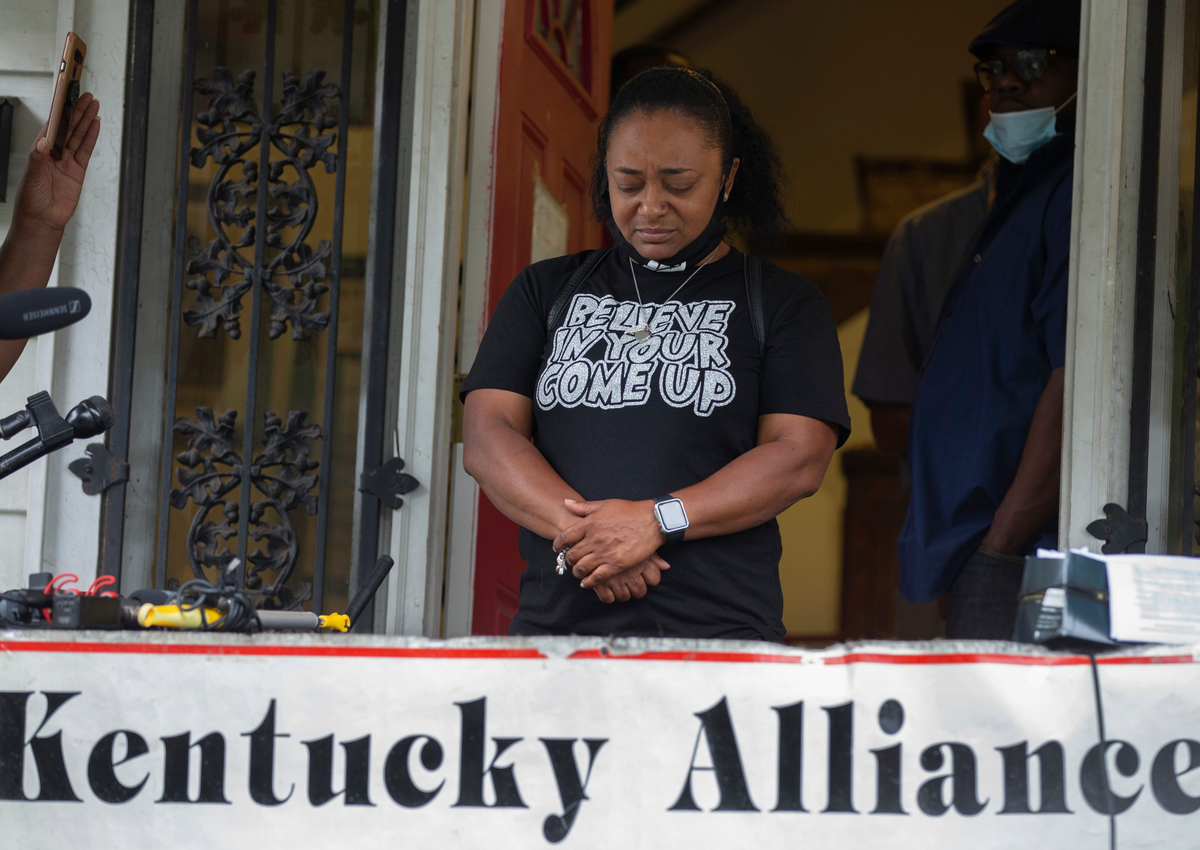 Tyra Walker of the Kentucky Alliance Against Racism and Poltical Oppression holds back tears as she addresses the shooting of a man at the camp of protesters at Jefferson Square Park. June 28, 2020