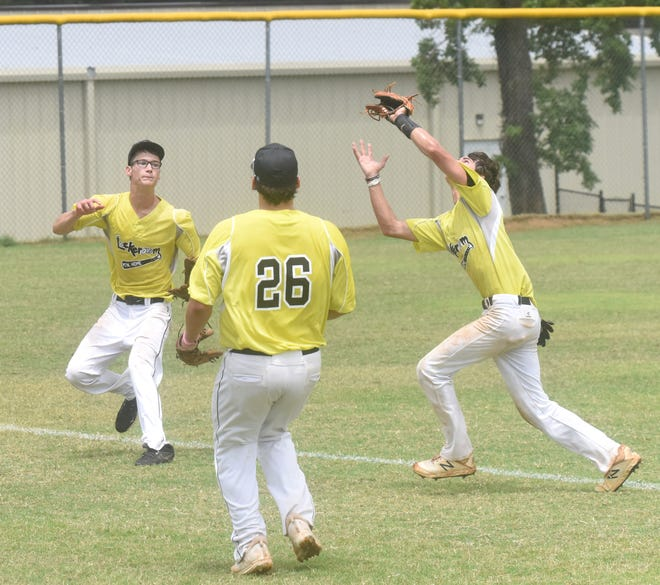 Lockeroom left fielder Will Uchtman (from left) and third baseman Will Gross give way to shortstop Josh Prinner for a fly ball during tournament action at Paragould on Saturday. Lockeroom defeated Pontotoc, Miss., 2-1, Saturday, and it defeated Batesville 13-0 on Sunday.