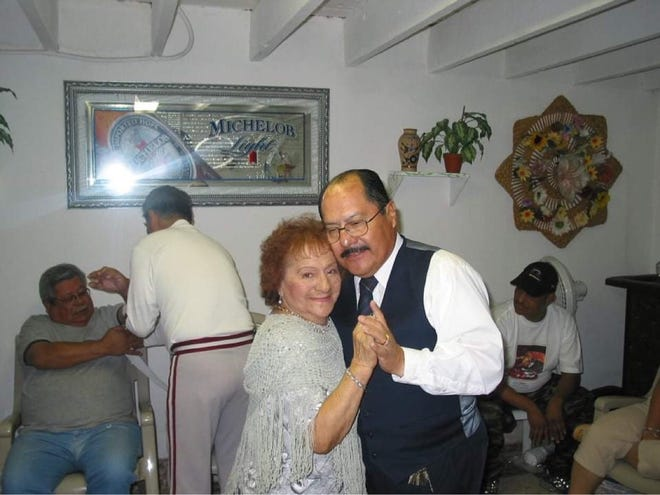 Sergio Vasquez, right, dances with his mother, Pilar, at a family gathering in this undated photo.