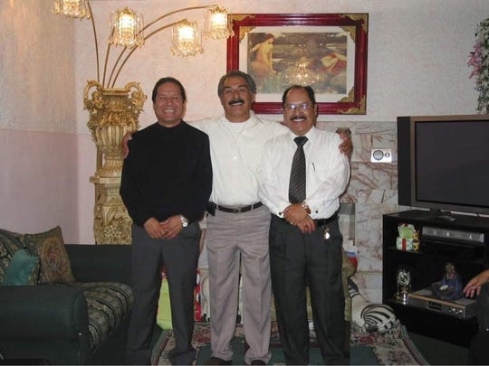 Sergio Vasquez, right, poses with relatives at a family gathering in this undated photo.