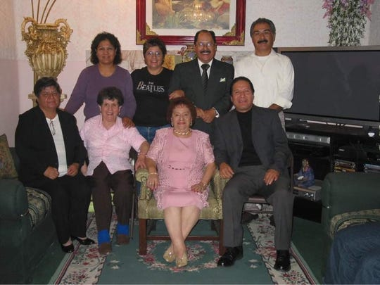 Sergio Vasquez (back row, second from right) poses with relatives at a family gathering in this undated family photo.