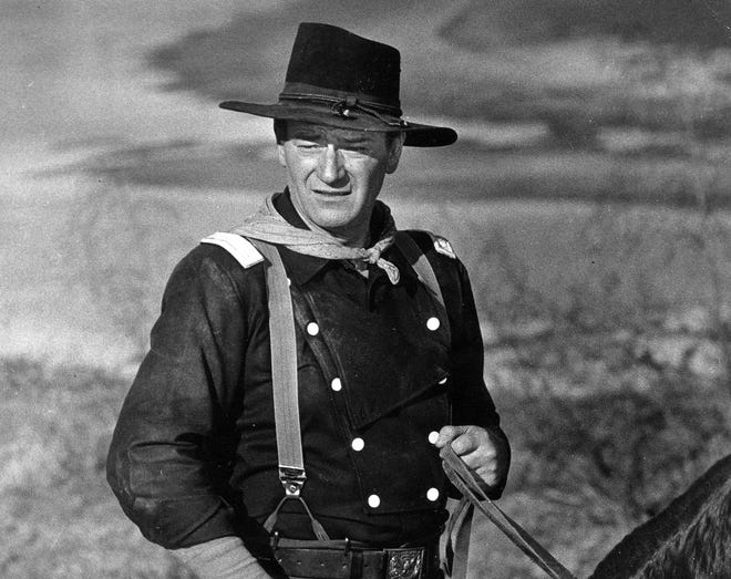 "In this undated photo, John Wayne appears during the filming of ""The Horse Soldiers."""