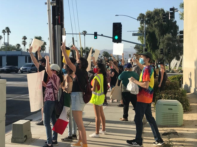 Protesters gathered Saturday in Indio near the Larson Justice Center to decry racism and police brutality.
