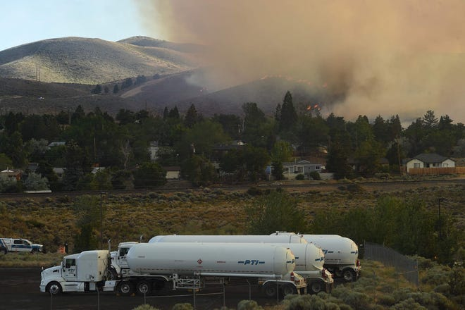 The Poeville Fire on and around Peavine Peak is shown on Saturday.