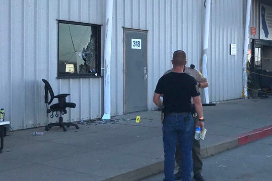A deputy interviews someone outside the Red Bluff Walmart distribution center after a shooting there in this Saturday, June 27, 2020 picture.