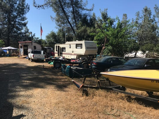 No one answered the door Sunday at the home where Shasta County sheriff's officials reported a shooting where two were killed and one injured Saturday near Shingletown.